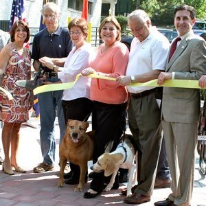 Local dignitaries -- and a couple of invited guests -- unveil the new doggy space.