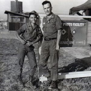 Fred Blumlein with Sgt. Lee Van Cua, a South Vietnamese army photographer attached to his photo unit, in front of lab where his squad's photos were processed and printed