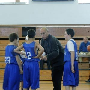 Port resident Coach Robbie Weingard speaks passionately  to his players during CYO's first fifth-grade basketball game last Sunday against St. Agnes in Rockville Centre.