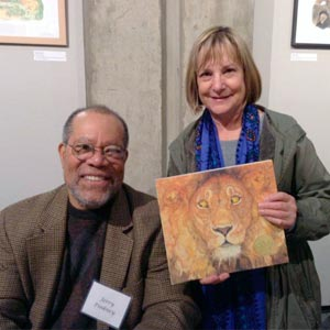 Author/illustrator Jerry Pinkney with library patron Nancy Graham.