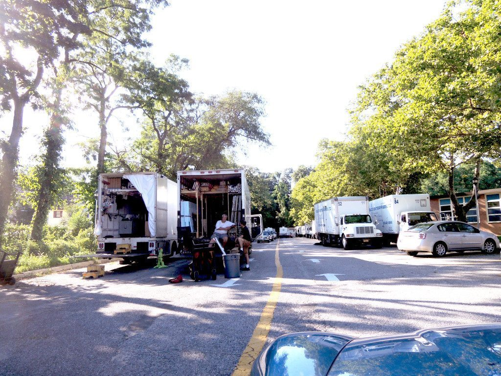 The driveway of Sousa Elementary School is lined with production trucks for filming the HBO pilot.