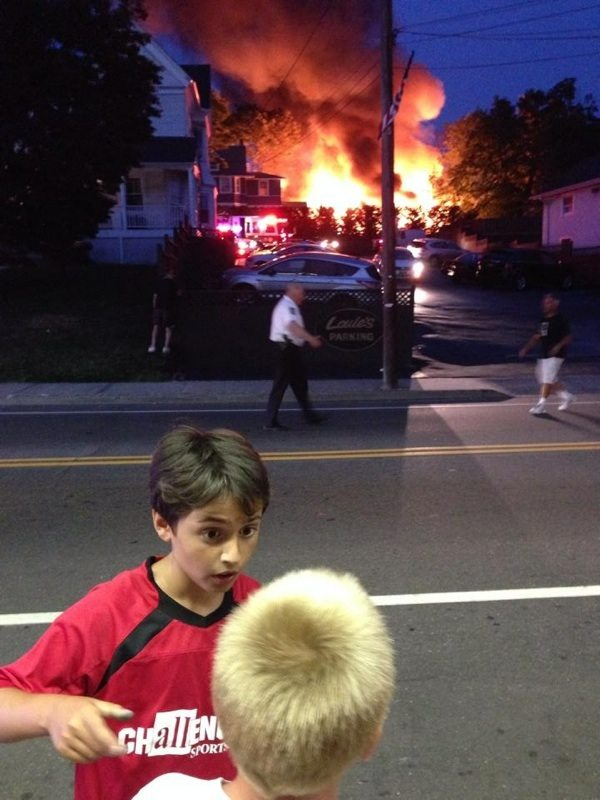 The sheer ferocity of the blaze astonishes these two kids.