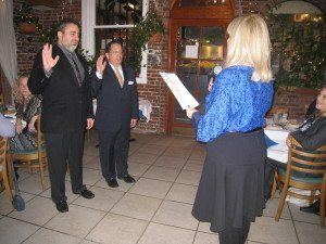 Assemblywoman Michelle Schimel administering the oath of office to chamber co-presidents Mitch Schwartz (l.) and Warren Schein at last year's ceremony