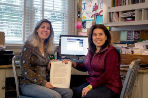 Deborah Abramson Brooks (left) and Allison White with their petition to stop inBloom. With all of the signatures and comments, the document runs nearly 500 pages.