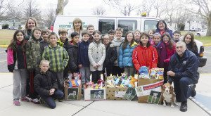Mrs. Lucie's class present donations to the town shelter.