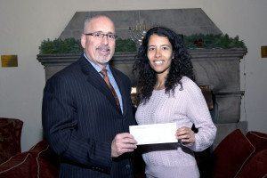 Marc Gann, Esq., a member of the Nassau County Bar Association  We Care Fund, gives grant to Leila Noor, director of development for the  Port Washington Parent Resource Center.