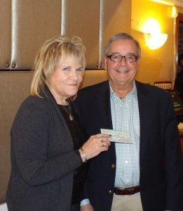 Manhasset Rotary President Esther Miller (left) presenting a $500 check to Tony D'Urso, representing Cross Cultural Thresholds.