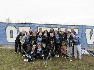 Coach Kaitlyn Carter, Kathleen Lennon and the Port Washington Girls Varsity Lacrosse team