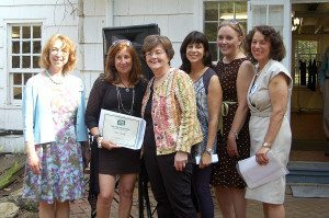Eileen Shea Neville (second from left) accepts the Terri Shkuda award from (left to right) Diane Bares, executive director of The Art Guild; Kathy Shkuda; Shelley Holtzman, co-president of The Art Guild; Delia DeRiggi-Whitton, county legislator; and Ilene Silberstein, co-president of The Art Guild, at The Art Guild's 2015 Members Showcase Garden Party Reception (Photo Credit: Susan Herbst)