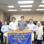 Members of the lacrosse team are presented with certificates at the Town of North Hempstead board meeting