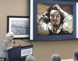 The residents of The Amsterdam at Harborside were mesmerized by a presentation given recently by Shirley Spector. The talk, entitled Artists Self-Portraits, featured works by many well-known painters including Gustave Corbet, who is shown in the photo above. Shirley Spector, a former docent at the Nassau County Museum of Art, is herself a resident of The Amsterdam at Harborside. (Photo by Edwin Hess)