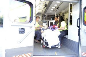 Fire Medics caring for a patient inside its ambulance about to leave for the hospital.