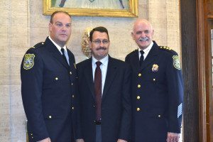 Lieutenant Thomas Ruehle with newly retired, 31-year member of the Sands Point PD, Chief Mark Mandel and new Chief of Police Richard Lertora