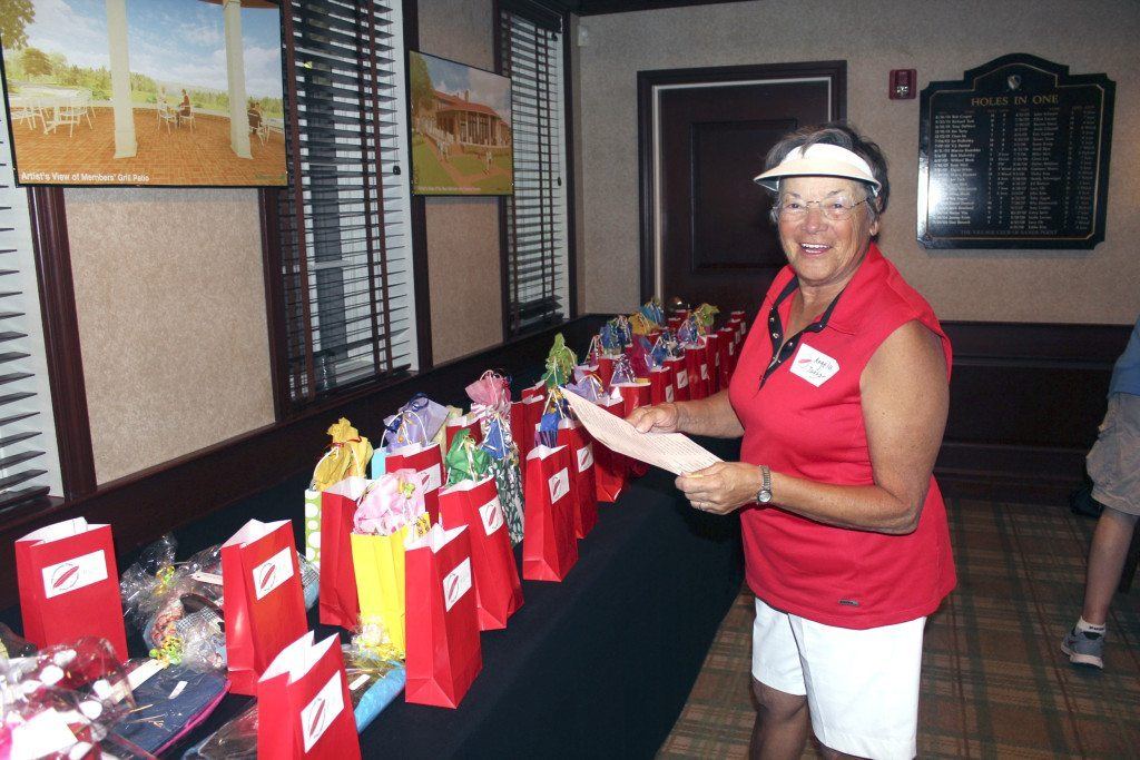 Angela Jaggar, who, along with husband Scott were Closest to the Pin Sponsors at the Community Chest Golf & Tennis outing on July 27, was pleased to see the many prizes donated by Port Washington retailers and friends.