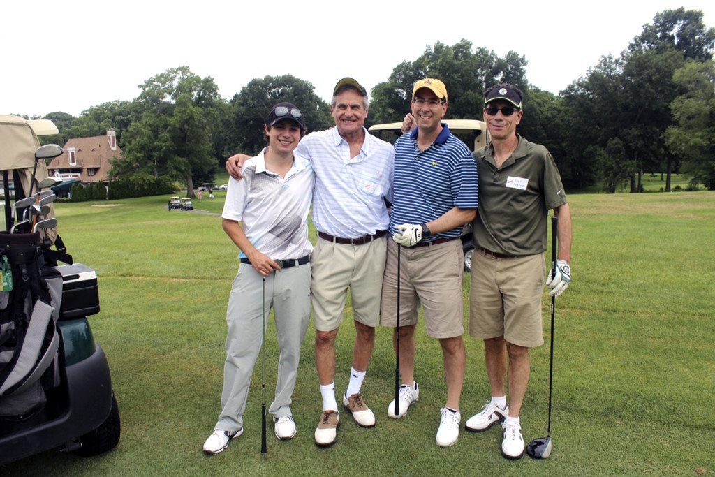 Matt Odell and his dad, Lee Odell, with Richard Fox and Joel Rogovin, enjoying the Tom Doak- designed golf course at the Village Club of Sands Point.