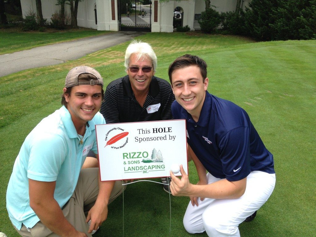 Brothers Luke and Will Rizzo, with Dan Carroll, proudly pose with the Rizzo & Sons Landscaping tee sign. Port Washington individuals and businesses helped make this year's outing a financial success with 12 major sponsors and 18 tee and cart sponsors.