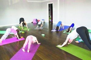 Kids learn to relax at Little Lotus Yoga