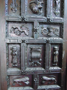 The original hand-carved wooden entry doors