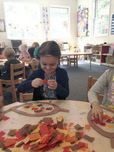 Student Natalie making leaves