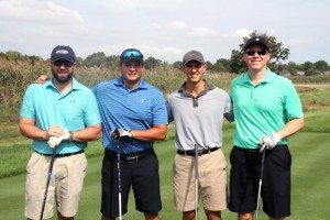 John Bowman (far right), owner of Greens Irish Pub, with his foursome out on the course