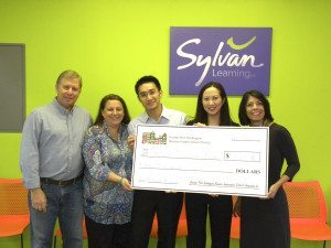 Scott Weil, board member of BID, Mariann Dalimonte, executive director of BID, Wing Ng and Lisa Yeung-Ng, owners of Sylvan Learning Center, Dina De Giorgio, councilwoman and board member of BID.