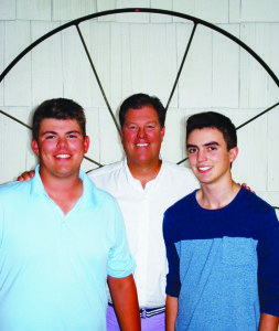 From left: Second-generation sailor Craig is flanked by his sons Griffin and Carson