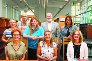 From left (back row): Trustees Christina Nadolne, Larry Greenstein, Elizabeth  Weisburd, Alan Baer and Emily Beys; front row: Vice President Nora Johnson,  President Karen Sloan and Superintendent Dr. Kathleen Mooney