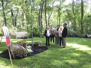 The Reichenbach family and  Mayor Elaine Phillips view the memorial plaque and Morning  Glory Maple planted in honor  of Karen Reichenbach