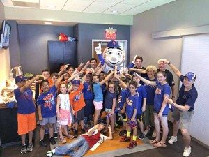 Shot of the library group hanging with  Mr. Met in a  Citi Field suite