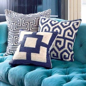 Add splashes of blue in varying patterns with these Jonathan Adler throw pillows. $135 to $200.