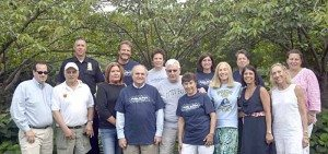 Representatives of Pride in Port committee and sponsors at Landmark Park. Front row from left: Daryl Zimbardi, Anthony Carpinelli, Toni Kessell, Fred Pollack, Fred Falconer, Barbara Faticone, Bonnie Doran, Dina DeGiorgio, Melissa Spitalnik. Back row: Bill Zwerlein, Mat Lanfant, Bobbie Polay, Karen DeLillo, Pat Hollran and Mariann Dalimonte.
