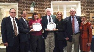 Sue Miller and John Browning came in first in everything. They are seen here accepting one of their awards, from left:  Bill McCollum, Dana Schnipper (crew), Sue Miller, John Browning, Stephanie Baas (crew), George Huntington (crew) and  MaryLu Dempsey-Palafox