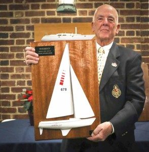 Ted Toombs holding the Herbert J. Schmidt, Jr., Memorial Race trophy. This beautiful half-model was designed and built by the master, George Huntington, who had made many beautiful half-models over the years.